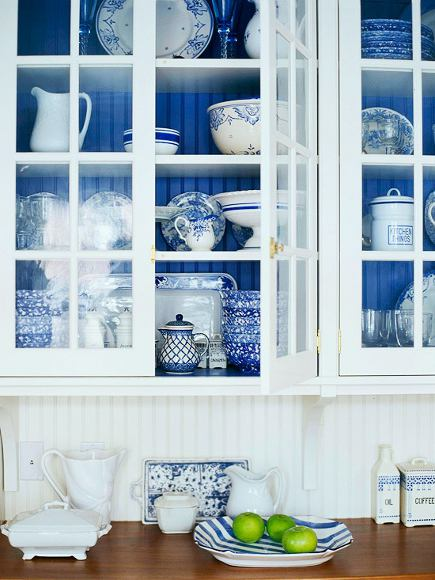 interior cabinet color - white kitchen cabinet with glass doors and cobalt blue beadboard behind the shelves - my green home via atticmag
