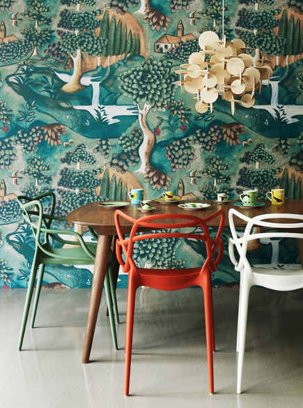dining room with Zoffany Verdure wallpaper by Melissa White, with Philippe Starck Masters chairs