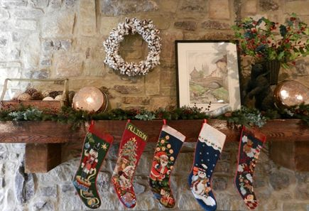 rustic Christmas mantel with natural cotton boll wreath
