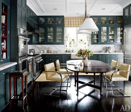 dark, inky green kitchen with double tier cabinets