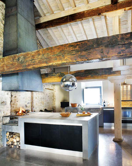 rustic modern Spanish kitchen with stone walls