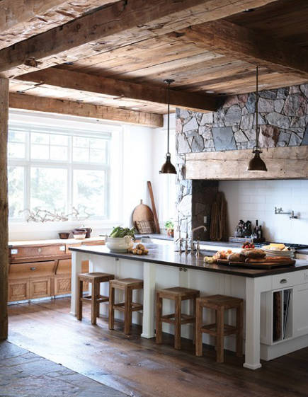 rustic modern kitchen with stone wall around stove niche