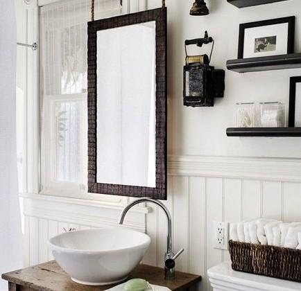 suspended mirror in a remodeled Victorian bathroom by Antonio Martins Interior Design via Atticmag