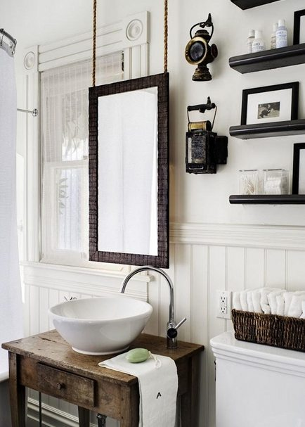 Victorian bathroom remodel featuring mirror hanging on chains by Antonio Martins Interior Design