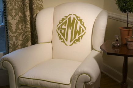 monogrammed easy chairs - white upholstered chair with green monogram and contrast piping - Brenda Kelly Kramer via Atticmag