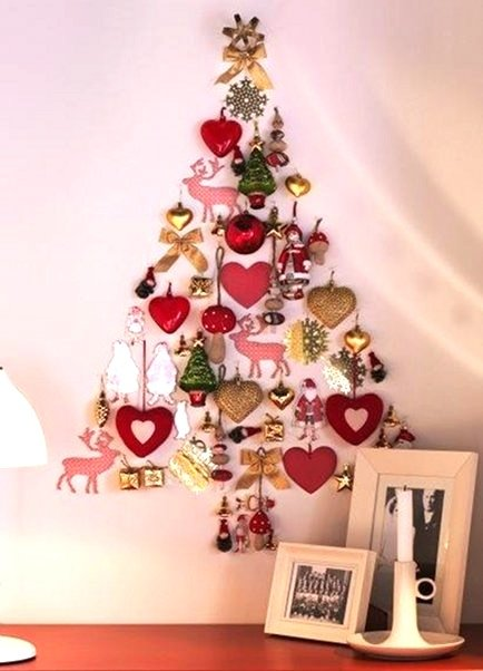alternative wall Christmas trees made with ornaments via Atticmag