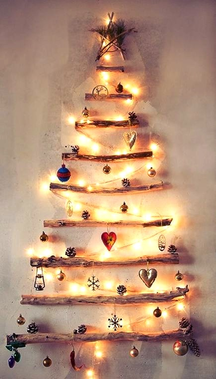 alternative holiday trees - wall driftwood Christmas tree - Jolie Home Design via Atticmag