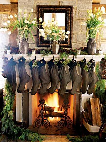 luxurious Christmas mantels, this one with natural cypress garland and dark green Irish stockings from Southern Accents via Atticmag