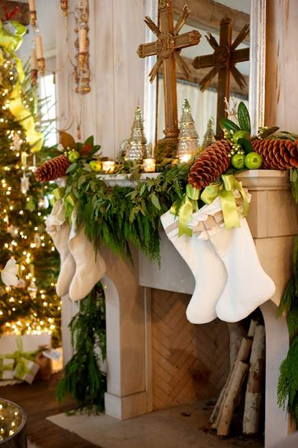 luxurious Christmas mantel with natural cypress garland, magnolia leaves and pinecones from StyleBlueprint
