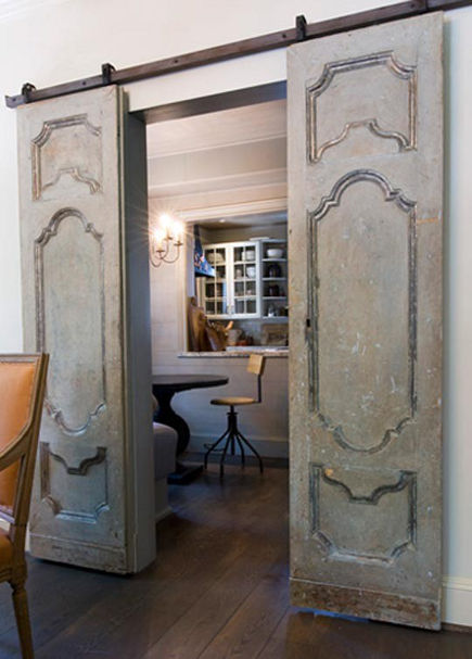 double interior barn doors with French Provincial style raised panels - Lynne Knowlton via Atticmag