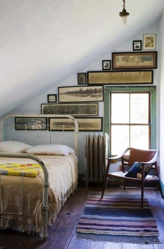 picture wall - cottage bedroom with vintage panorama photographs hung on an asymmetric wall - tuzvbiber via atticmag