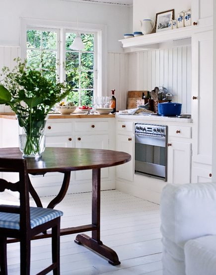 antique wine tasting table in an all white kitchen - inspiring interiors via atticmag