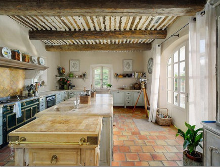 French butcher block cart adjacent to island in a French kitchen
