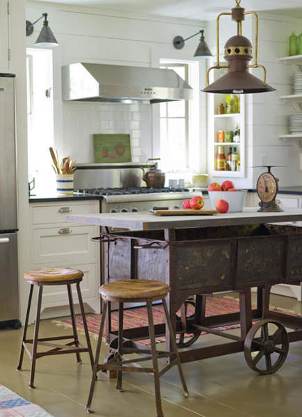 white kitchen with industrial steel wagon made into a kitchen island 