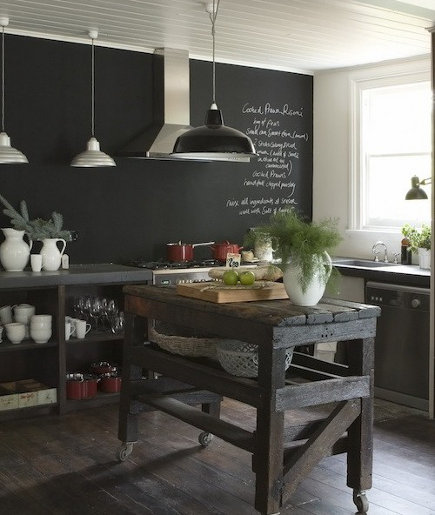 informal dark gray-painted kitchen with rough hewn island on wheels