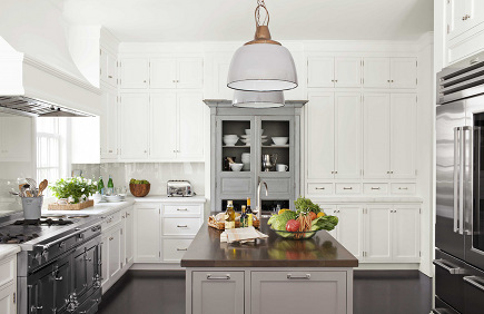 antique gray French armoire set into wall of kitchen cabinets from House Beautiful