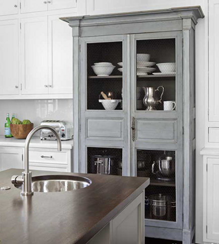 antique French gray hutch set into wall of kitchen cabinets - House Beautiful via atticmag