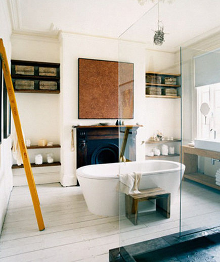 bedroom with fireplace converted into a bathroom with glass-enclosed shower