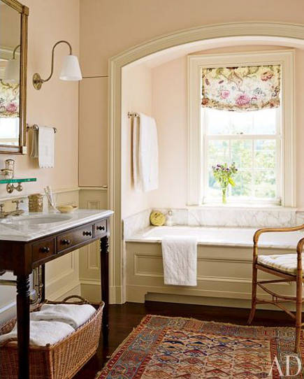 bathroom with antique table as sink vanity, Caucasian rug and antique bamboo chair