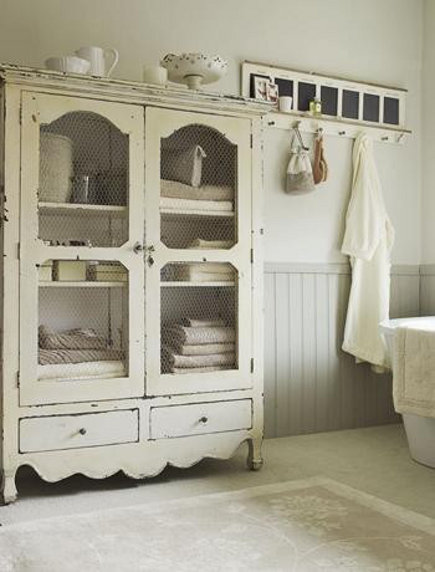 cottage bathroom ideas - large white storage armoire and coat rack - 58 cherries via atticmag