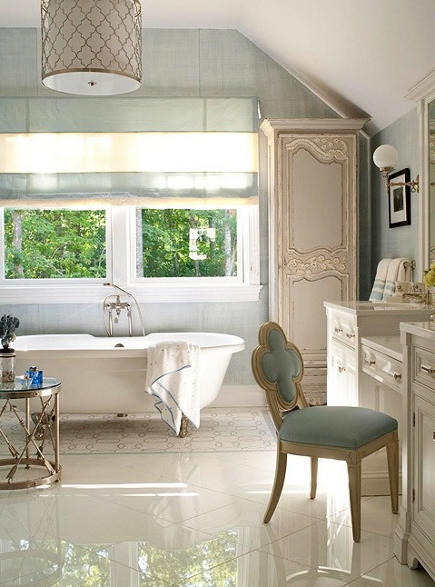 bathroom with built in vanity, upholstered side chair, and glass and grass occasional table