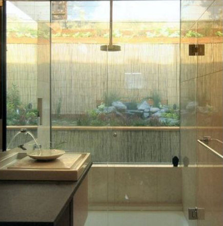Japanese style bath with outdoor garden visible from the shower