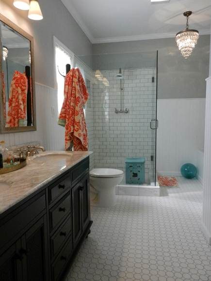 white subway tile master bathroom remodel with glass shower enclosure