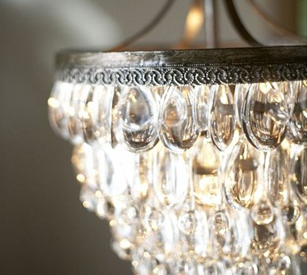 Pottery Barn Clarissa crystal chandelier in the bathroom via Atticmag