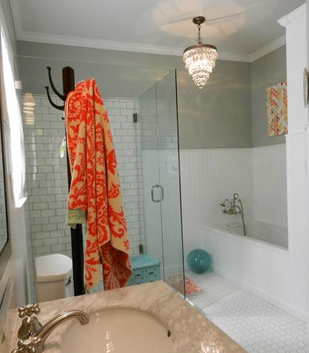 white painted wood wainscot and tub apron in master bath redo - Atticmag