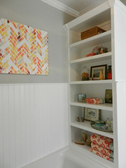 white painted bookcase in master bathroom tub niche via Atticmag