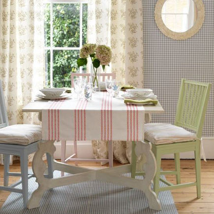 Swedish style cottage room with a red and white striped table cover