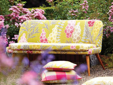 scandinavian style settee upholstered in large scale Delphine print from Harlequin