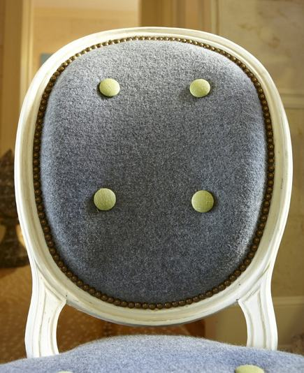 cameo back French chair covered in boiled wool fabric with decorative buttons by Amanda Nesbit