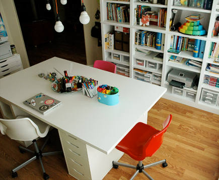 large work table assembled from ikea tops, drawers and shelving units