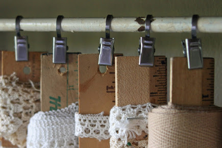 crafts room ideas - simple clips used as hangars clipped to paint stirring sticks - mamiejanes via atticmag