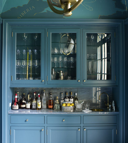 Chinese blue cabinets in a butler's pantry and bar designed by Miles Redd