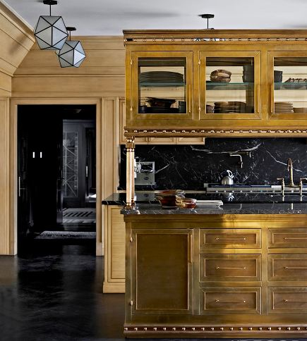 brass kitchen cabinets by Kelly Wearstler