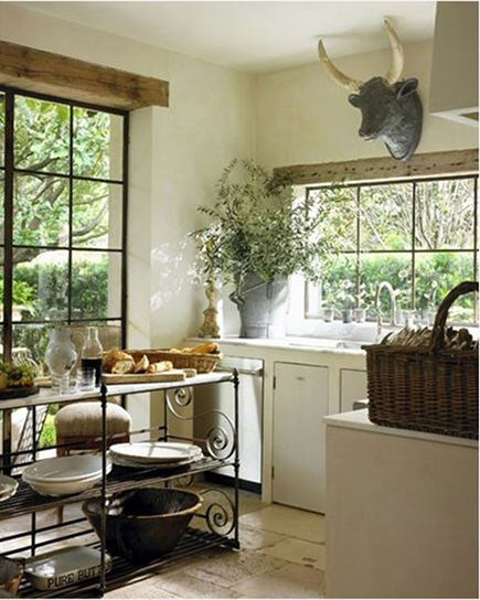 wrought iron open island in rustic French kitchen by Pamela Pierce