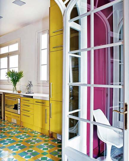 yellow kitchen cabinets and colorful cement floor tiles
