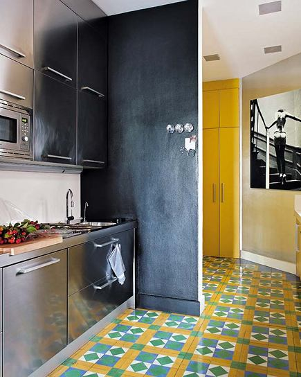 stainless steel kitchen cabinets with colorful cement tile flooring