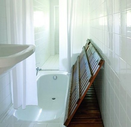 concealed bathtub hidden under wooden slatted floor- Marie Claire Maison via Atticmag