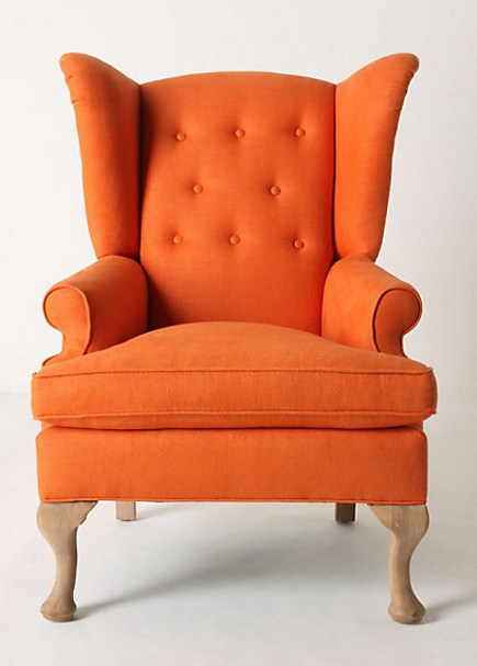 accent colors - orange Howell wingback chair - Anthropologie via atticmag