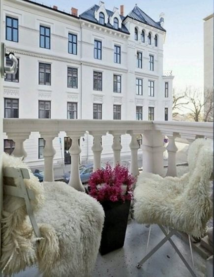 shearling area rugs used on outdoor chairs - tumblr via atticmag