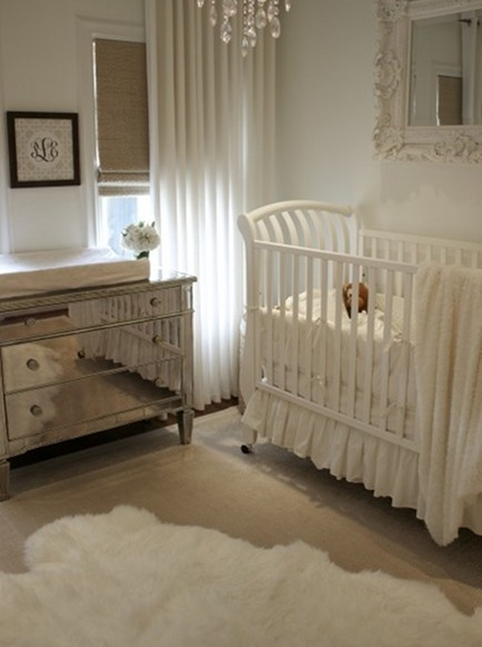sheepskin rug in a white nursery