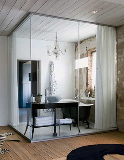 modern interior glass wall bathroom in rustic villa