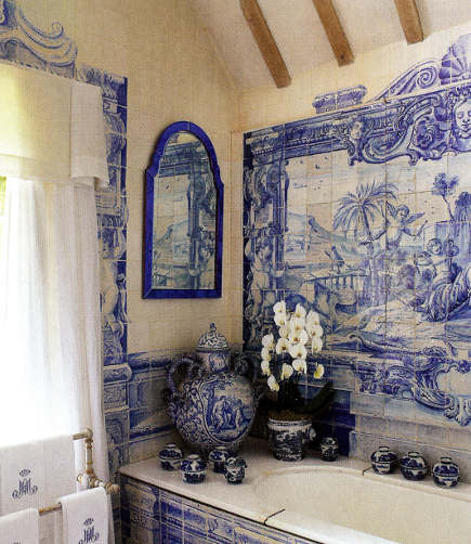 Anouska Hempel's bathroom with blue and white tile bathroom with Delft tiles murals and detailing - Architectural Digest via Atticmag