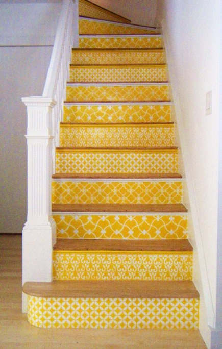 yellow and white geometric stenciled staircase by Carol Leonesio