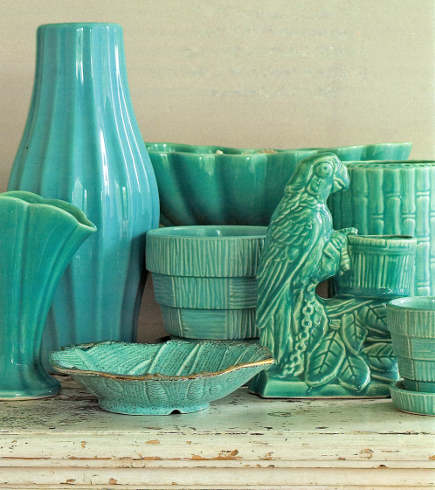 displaying ceramics - turquoise 1950s Haeger and McCoy pottery collection - country living via atticmag
