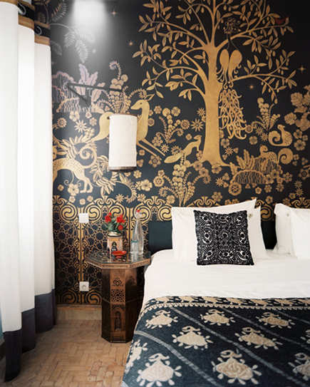Moroccan decor - gold painted stenciled bedroom wall at Peacock Pavilions hotel, Marrakech, My Marrakesh via atticmag
