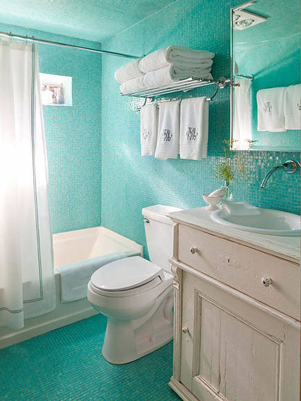 bathroom with turquoise blue glass mosaic floor, walls and ceiling